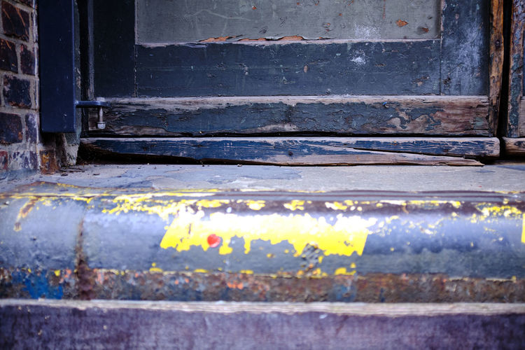 Close-up of weathered wooden door of building
