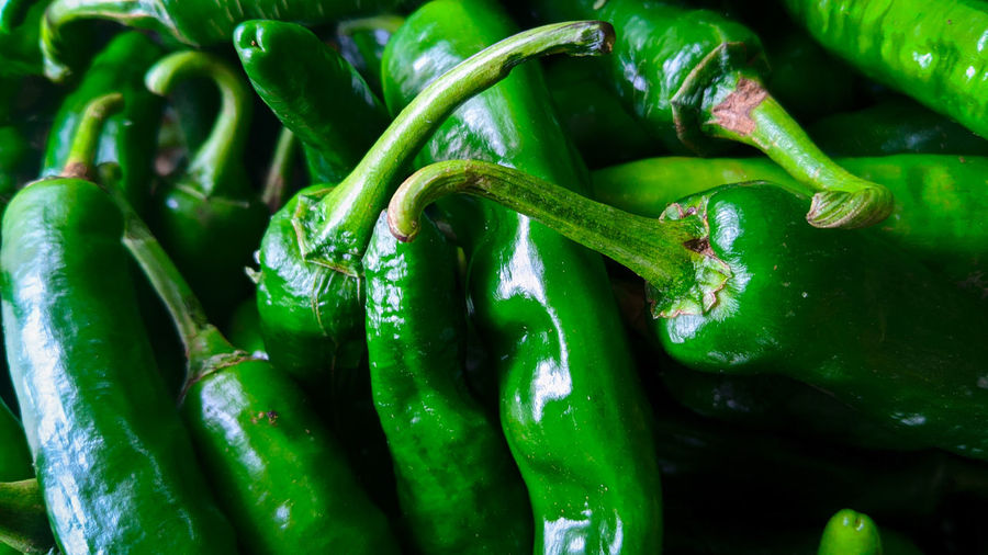 Full frame shot of green chili peppers at market