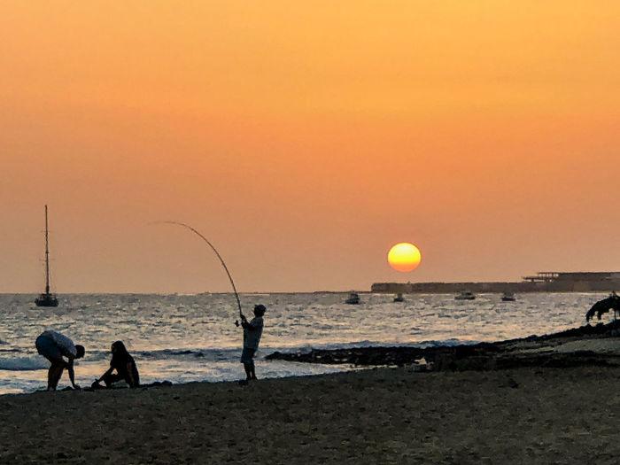 Fishing from the beach at sunset, Santa Maria, Sal Island, Cabo Verde Sky Water Sea Sunset Beach Fishing