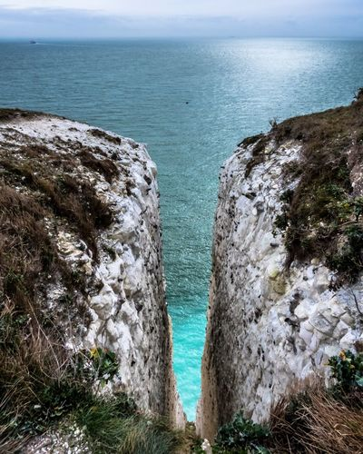 Waterfall or not? — White Cliffs of Dover Sea Water Scenics - Nature Horizon Rock Beauty In Nature Nature No People Land Rock - Object Horizon Over Water Tranquility Rock Formation Day Solid Cliff Tranquil Scene Outdoors Beach Turquoise Colored Eroded Uk Cliffs Dover Waterfall