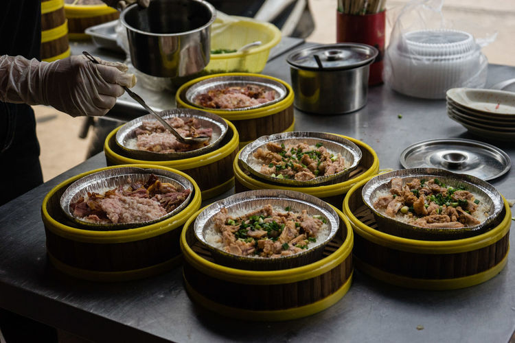 Foodphotography Food And Drink Travel Traveling Travelling Travel Photography Travel Destinations China Zhuhai Food Freshness Table Bowl Human Body Part Human Hand Indoors  Healthy Eating Asian Food Plate Wellbeing Hand Focus On Foreground Choice High Angle View One Person Chinese Food Ready-to-eat Variation Korean Food Street Food