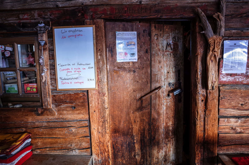 Dolomites Entrance Wood Abandoned Architecture Built Structure Cabin Communication Day Desolate Door Hanging Hut Mask No People Obsolete Outdoors Run-down Rusty Text Tyrol Weathered Wood - Material