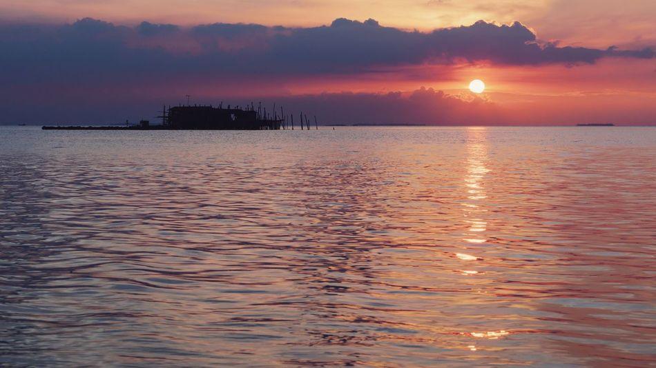 Sunlight Sunshine Golden Hour Silhouette Kelong Reflection Silhouette Sea Copy Space Landscape Water Low Tide Wave Nautical Vessel Sea Sunset Beach Horizon Urban Skyline Romantic Sky Seascape Coast Coastal Feature Coastline