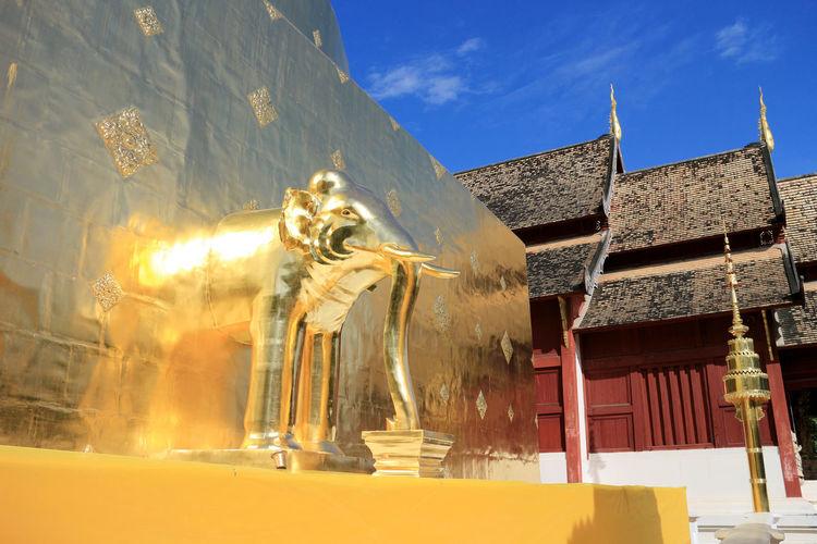 Wat Phra Singh, Lion Buddha Temple Architecture Gold Golden Lion Buddha Temple Pagoda Reflection Roof Statue Wat Phra Singh Wat Phra Singh Woramahawihan Architecture Art And Craft Belief Believe Buddhism Building Creativity Elephant Religion Representation Sculpture Sky Spirituality Sunlight Temple