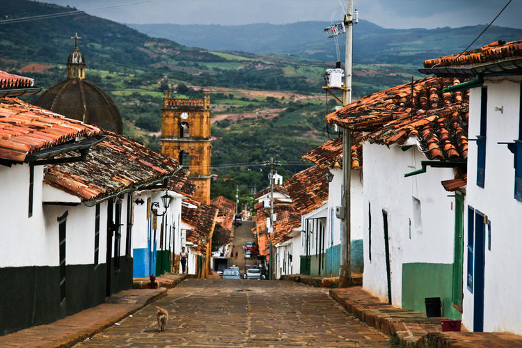 Narrow Alley Along Red Tiled Buildings In Colombia