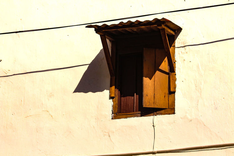 No People Outdoors Day Architecture Old Wooden Window Frame Old Wooden Window White Wall Copy Space Old Wooden Window In A White Wall Streets Of Penang George Town, Penang, Malaysia The Week On EyeEm Penang Malaysia Wood - Material