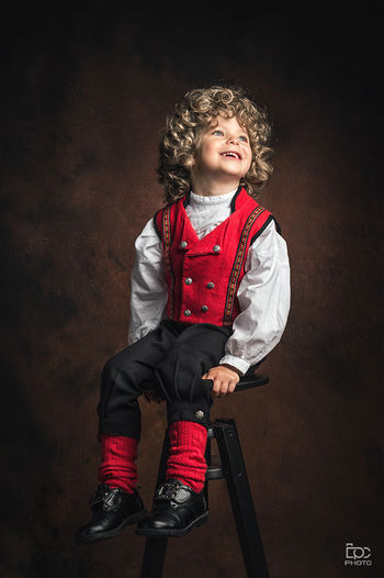 17mai Norge Nationaldag Gratulerermeddagennorge Norges_fotografer Eidsvoll Akershus Dpcphoto2015 Norway Studio Gutt Boy Norsk Happyday Nationalcostume  Curlyhair Lillestrøm Madeinnorway Bunad Mastershots Photography Photooftheday Child Childhood Portrait Full Length Studio Shot Smiling Front View Brown Background