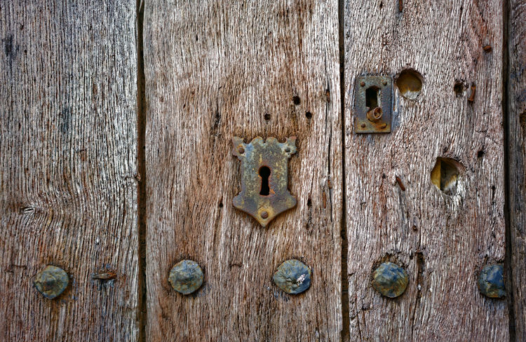Old door and keyholes Locks Textures and Surfaces Backgrounds Close-up Closed Details Door Entrance Hole Keyhole Lock Metal No People Old Protection Rusty Safety Security Weathered Wood Grain Wooden Texture