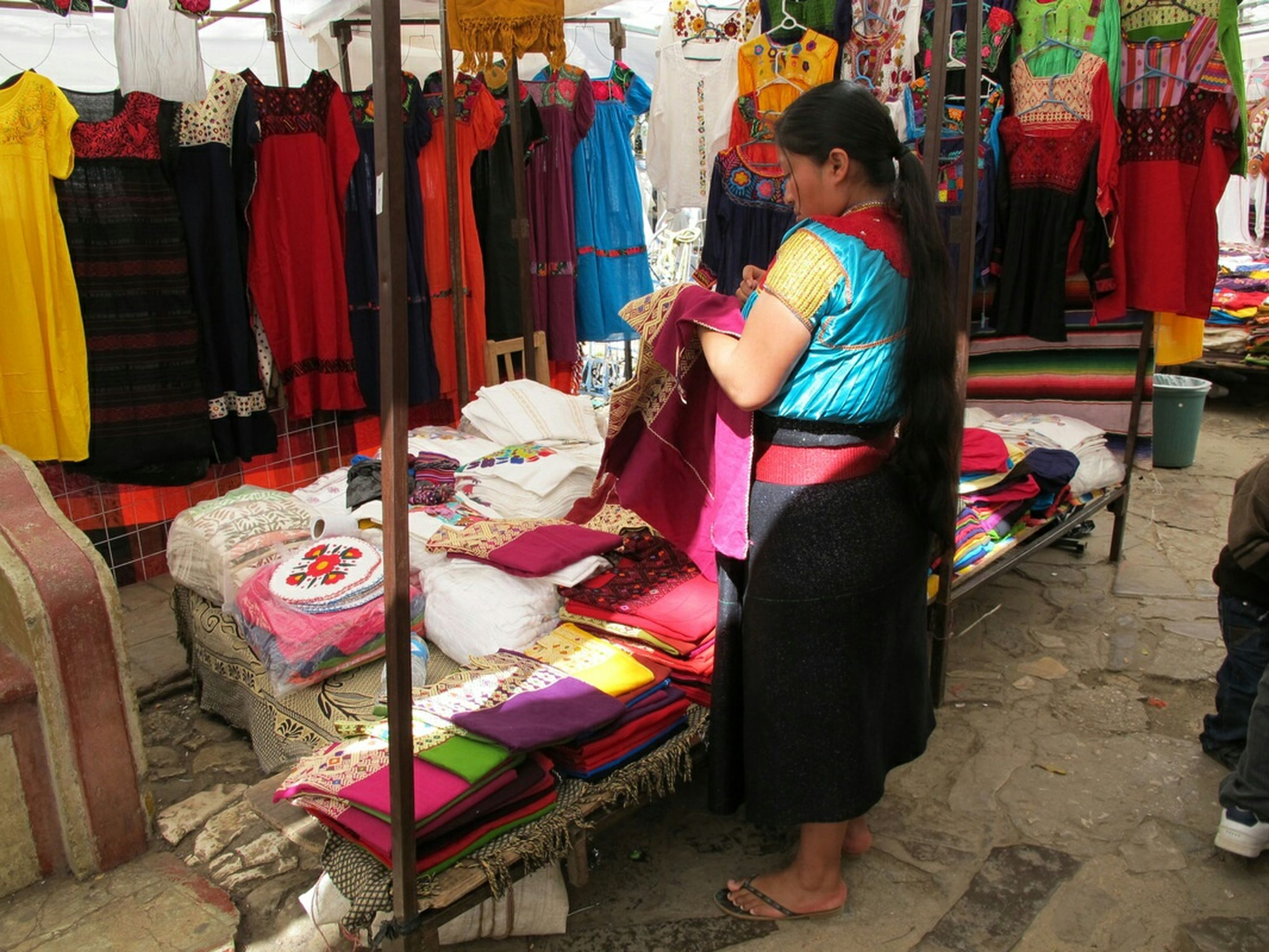 retail, lifestyles, person, multi colored, built structure, men, market stall, market, building exterior, architecture, for sale, clothing, store, standing, casual clothing, variation, traditional clothing, cultures