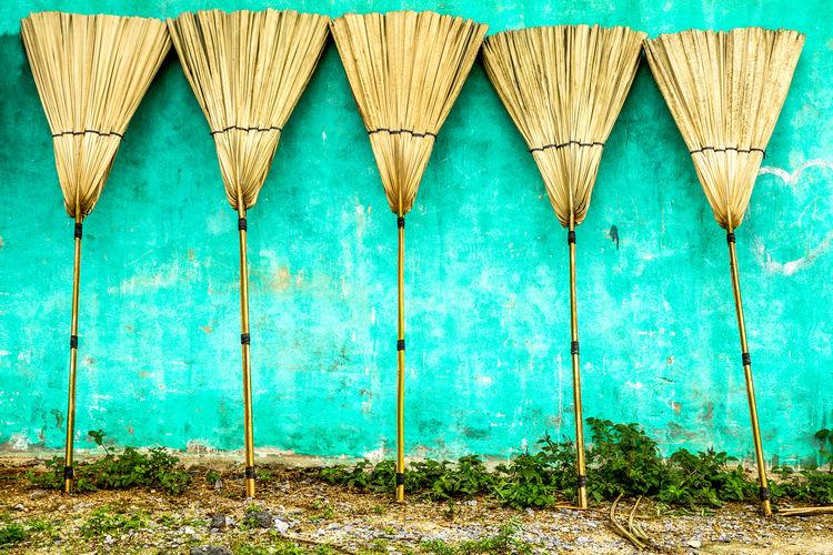 Multi colored umbrella on wooden wall