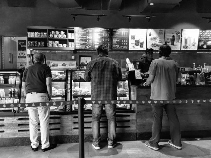 Rear view of people standing in store