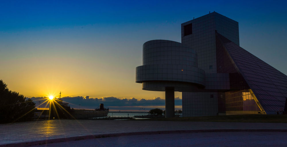 Golden Hour Sunset at Rock n Roll Hall of Fame Architecture City Cleveland Exterior Golden Hour Horizon Lake Erie Landscape Landscape_Collection Landscape_photography Modern Museum Rock And Roll Hall Of Fame Rock Hall Rock N Roll RockandRoll Sky Sun Sunbeam Sunlight Sunset Travel Destinations Urban Geometry Urban Landscape Water Reflections
