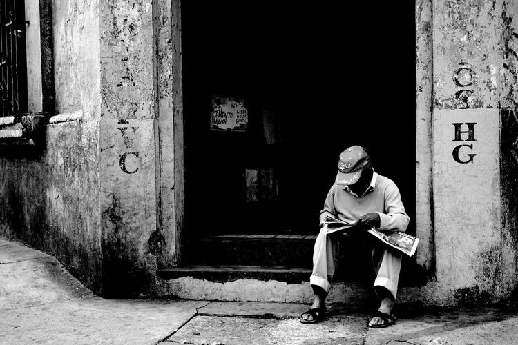 One Person One Man Only People Grandpa Grandfather Street Photography Urban Exploration Still Life Jan2010 Urban Photography Streetphotography City Street City Streets View Fine Art Store Storefront View Storefront Street Corner Street Life Man Reading Newspaper Newspapers Sunday Morning Old Man Sitting Old Man Reading Reading The Paper Black And White Friday Focus On The Story