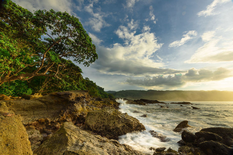 One of beautiful spot in the corner of Sawarna Sea Cloud - Sky Sky Water Beauty In Nature Rock Scenics - Nature Land Rock - Object Nature Beach Solid No People Tranquility Tranquil Scene Mountain Coastline Outdoors Rock Formation Horizon Over Water Bay Sawarna INDONESIA West Java