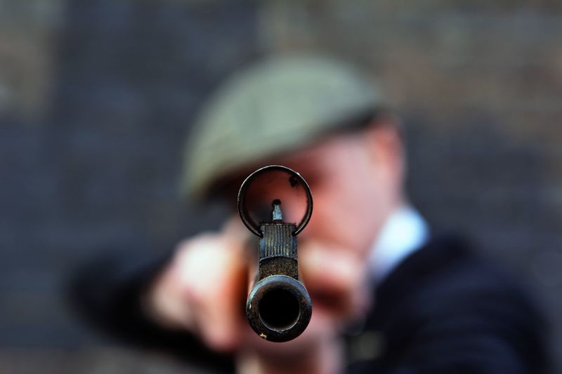 Close-Up Of Man Aiming With Rifle