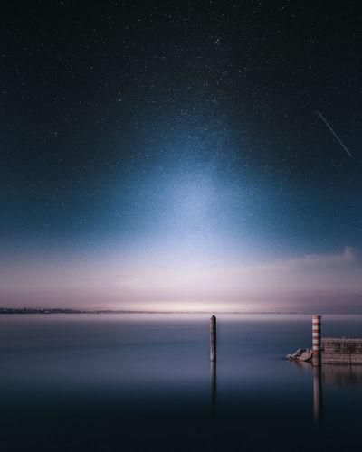 Lago di Garda Lago Di Garda PeschieraDelGarda Astronomy Beauty In Nature Clear Sky Galaxy Horizon Over Water Nature Night No People Outdoors Scenics Sea Sky Star - Space Tranquil Scene Tranquility Water