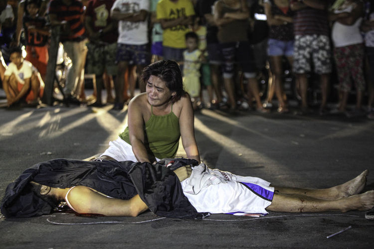 A woman grieves before the body of her son, a former drug user, who was shot dead by still unidentified gunmen along Herbosa Street, Tondo Manila Philippines last October 3,2017 dawn Monday. ( Jun Ryan Arañas ) Drugs Manila, Philippines Mother And Son Night Photography Philippines Graveyard Journalism War On Drugs