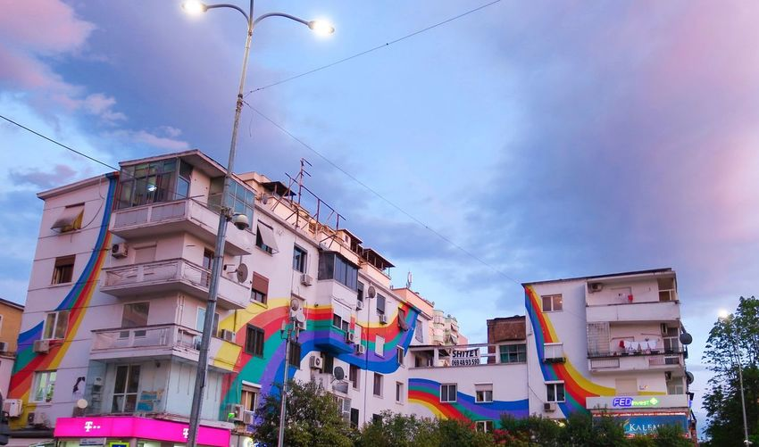 Rainbow Building Exterior Sky Architecture Built Structure Cloud - Sky Low Angle View Building Lighting Equipment Outdoors House Day Street Light Window City Nature Multi Colored Residential District Street Hanging No People EyeEmNewHere A New Beginning