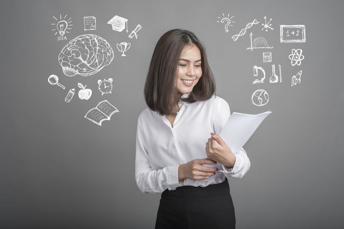 Adult Blackboard  Businesswoman Certificate Creativity Education Formula Graduation Holding Indoors  Knowledge One Person One Woman Only One Young Woman Only Only Women School Smiling Standing Student Studio Shot Success University Well-dressed Young Adult Young Women