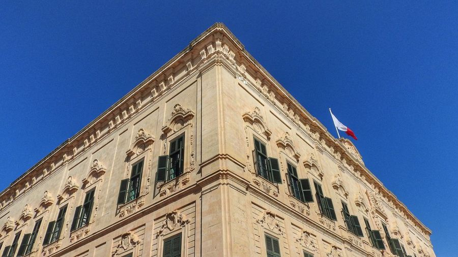 Low angle shot historical architecture in Valetta, Malta Architecture Baroque Blue Blue Sky Building Exterior Built Structure Clear Sky Day Façade Flag Low Angle View No People Outdoors Patriotism Sky Windows