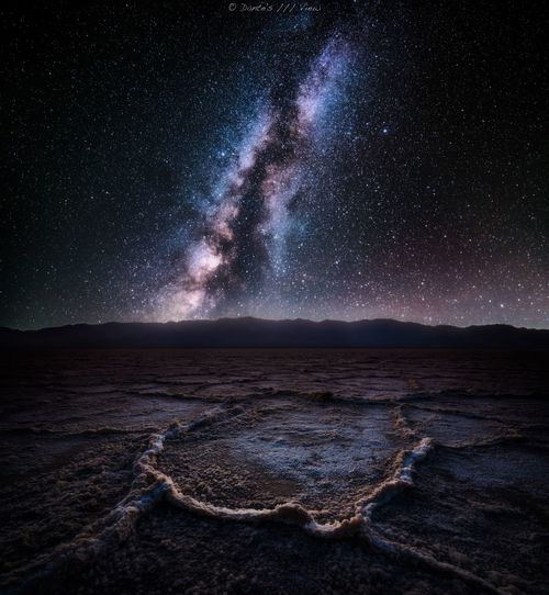 Scenic View Of Dramatic Landscape Against Sky At Night