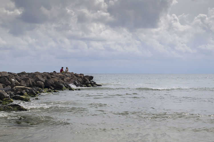Cloudy Day A Boy And A Girl Beach Beauty In Nature Black Sea Cloud - Sky Day Horizon Horizon Over Water Nature Outdoors People Rock Scenics - Nature Sea Sky Watching The Horizon Water Waterfront