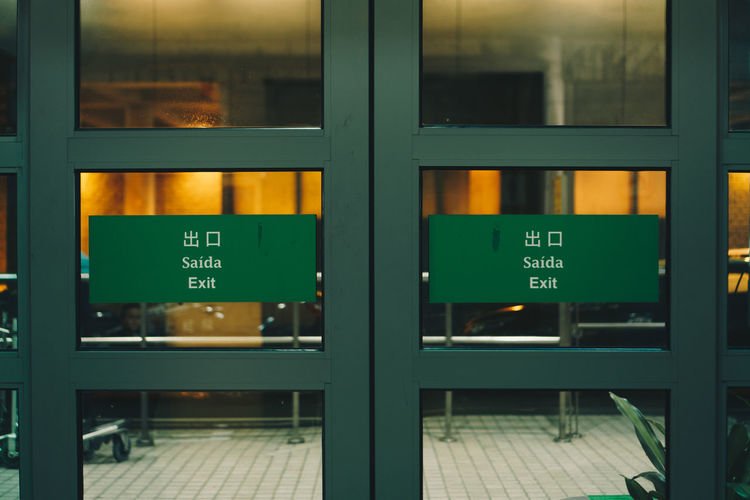 Exit signs on glass doors