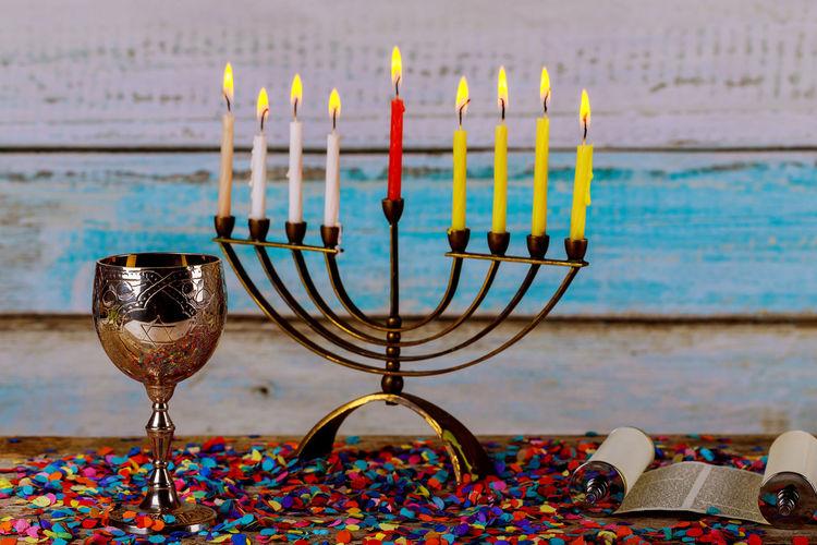 Illuminated Hanukkah candles on gold menorah Hanukkah candles Torah Ancient Rituals Burning Candle Chanukah Candles Faith Hanukkah Menorah Hanukkah Candles HanukkahDecor Menorahcandles Candlelight Chanuka Chanukah Hanukkah Hanukkah Dreidel Hanukkiah Judaism Kislev Menorah Orthodox Religion Sabbath Sabbathday Synagogue