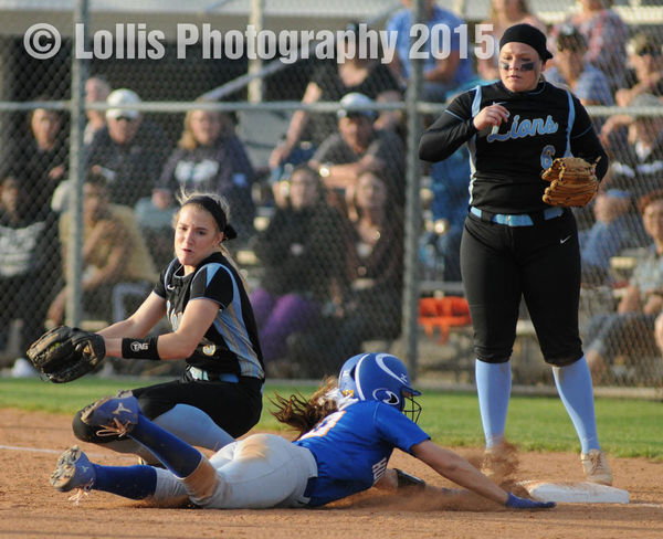 Wren Hurricanes Softball Sports Photography High School Sports Runner appears to be safe but the umpire called her out. Wren Softball Sports Photography