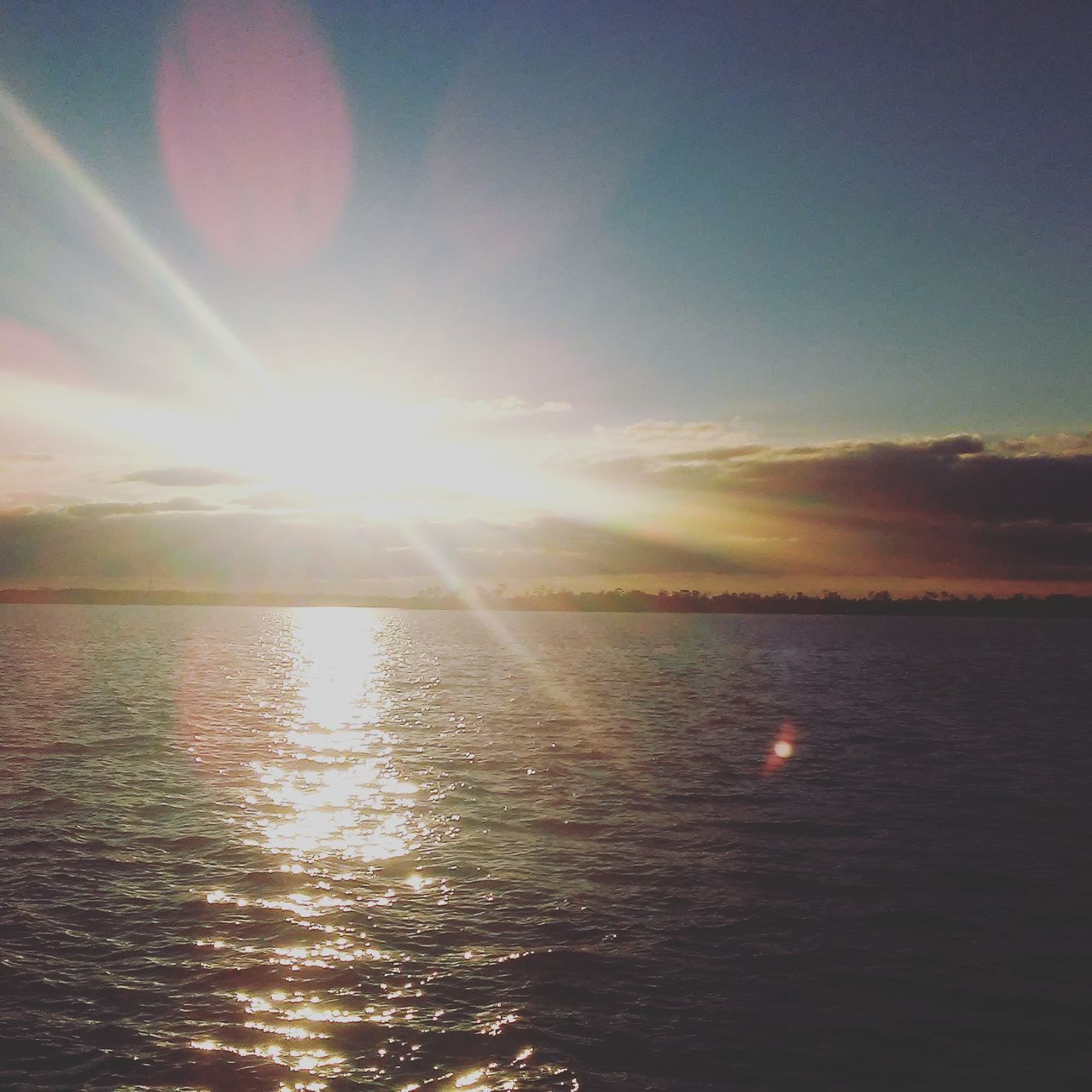 sun, sunset, sunbeam, lens flare, sunlight, scenics, beauty in nature, nature, tranquility, tranquil scene, sea, sky, no people, idyllic, reflection, water, outdoors, day