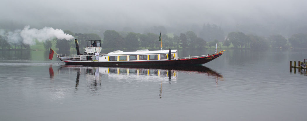 steam Yacht gondola coming in to dock Boat Calm Coniston Waters Lake Misty Morning Nautical Vessel Non-urban Scene Overcast Scenics Steam Boat Tranquility Water