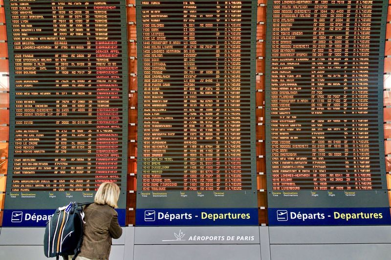 France, Paris: at Charles de Gaulle CDG airport, departure timetable Airport Repetition Multiple Objects Horizontal Day Timetable Departure Destination From Behind Unrecognizable Person Woman Backpack Vacations Leaving Doubt Searching List One Person Text Rear View Business Communication Adult Standing Western Script Transportation Hair Sign Architecture Real People Finance Travel Jacket Information Indoors  Travel Destinations Hairstyle