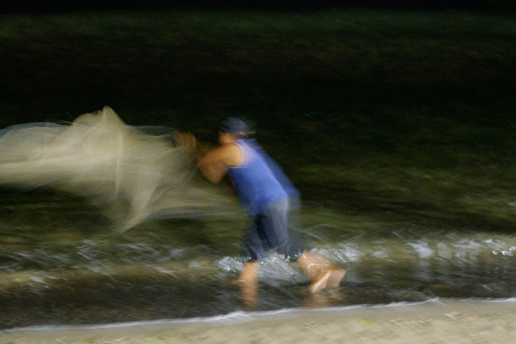 Net Fishing Waters Edge Beach Blurred Motion Fishing Fishing Nets Full Length Long Exposure Men Motion Nature Night Night Time One Person Outdoors People Real People Speed Traditional Water