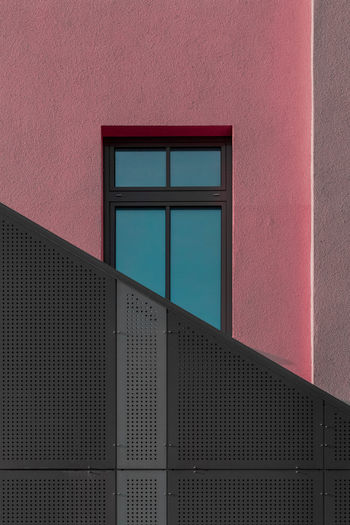 Abstract shapes of building with sky seen through window