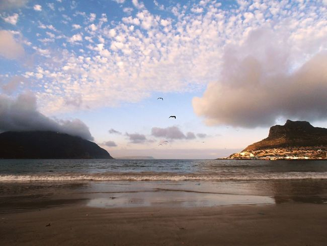 Hout Bay beach, South Africa. Sea Beach Hout Bay Hout Bay Beach Beauty In Nature Clouds And Sky Mountains Tranquil Scene Scenics Beauty In Nature Cape Town Nature Idyllic Clouds South Africa Travel Destinations Spectacular View South Africa Is Amazing