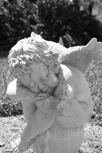Angelgel statue] Weathered