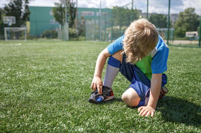Full length of girl playing on grass
