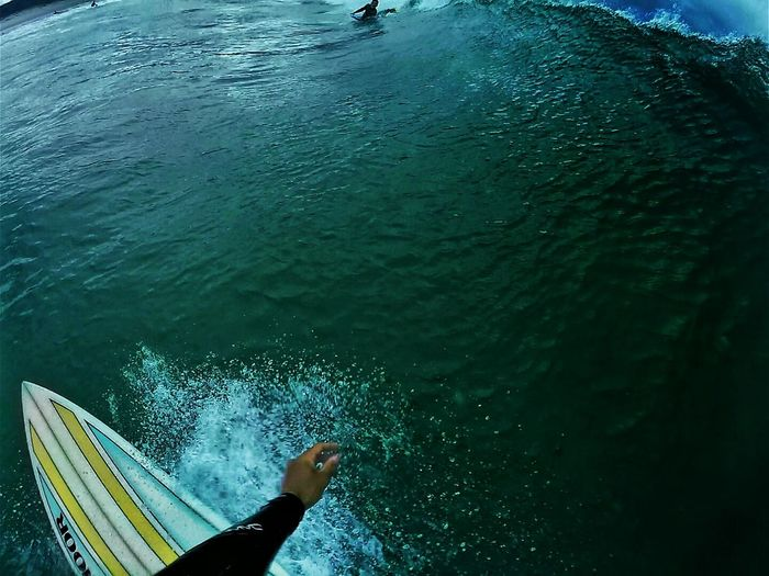 Cropped image of person surfing in sea