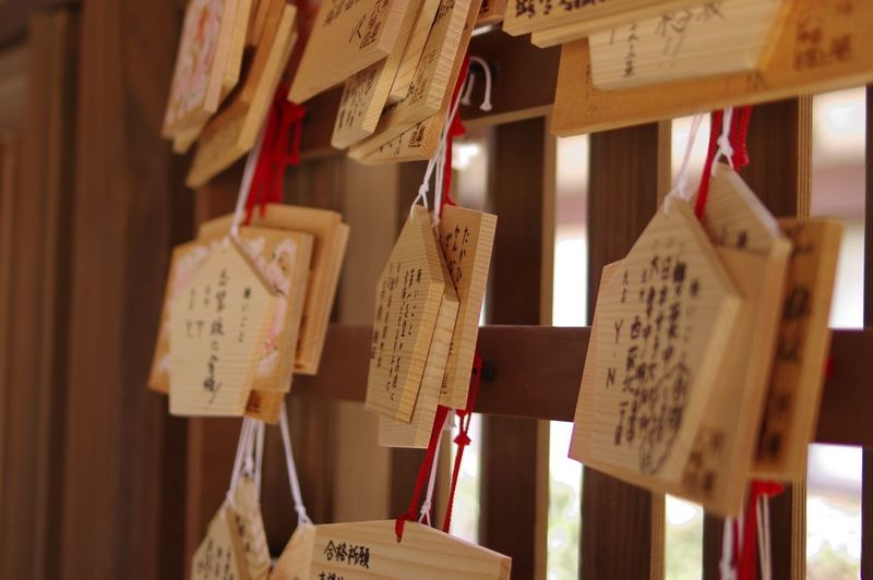 Close-Up Of Prayer Cards Hanging At Shrine