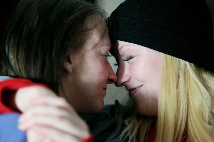 Close-Up Of Lesbian Couple Romancing At Home