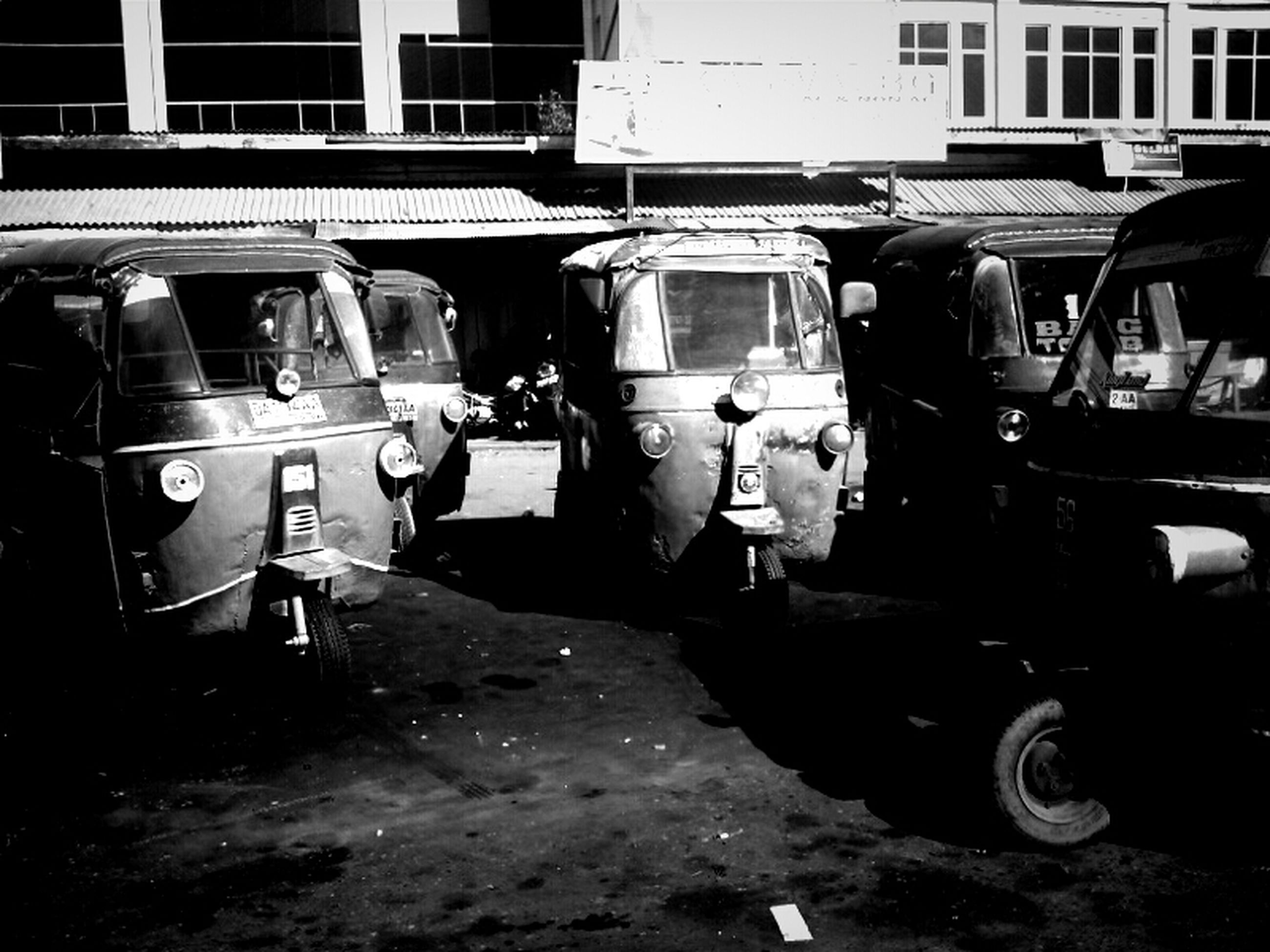 transportation, mode of transport, building exterior, land vehicle, architecture, built structure, street, car, stationary, day, outdoors, window, parked, in a row, building, parking, abandoned, city, obsolete, old