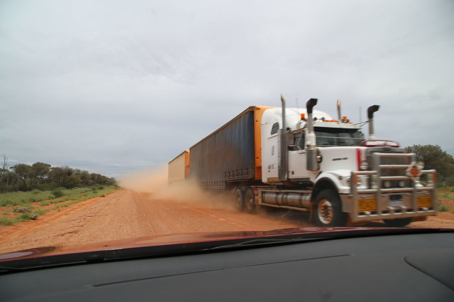 Car Commercial Land Vehicle Day Driving Gravel Road Land Vehicle Mode Of Transport Motion No People Outback Outback Australia Outdoors Red Sand Road Speed Transportation Truck