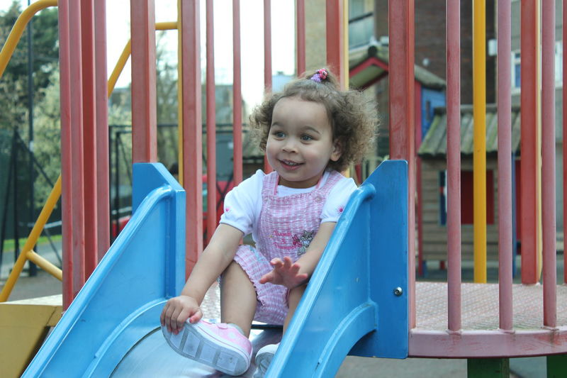 EyeEm Selects Childhood Playground Outdoor Play Equipment Front View Sitting Happiness Smiling One Person One Girl Only People Playing Fun Day Enjoyment Outdoors Girls Leisure Activity Children Only Child Full Length daughter princess Beauty Kidsphotography Nala❤ Cuteness