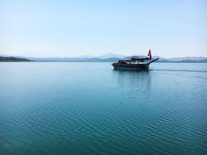 Lake Boat Mountains Background Flag Turkey calmly IPhoneography Iphonephotography Iphn Photography Day Scenics Outdoors Tranquil Scene Beauty In Nature Landscape Water