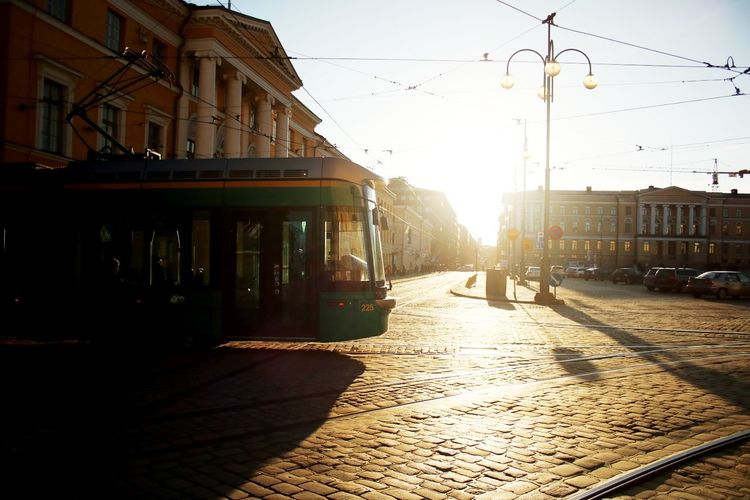 Building Exterior Architecture Street City Outdoors Sunset Built Structure Sunlight Cobblestone City Life Sky No People Nature Day Helsinki Tram Traveling Senaatintori Silhouette