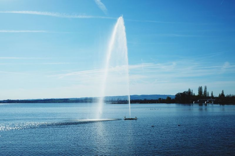 Fountain Switzerland Zug Water Sky Spraying Fountain Motion Nature Day Splashing No People Lake Blue Waterfront Outdoors Cloud - Sky
