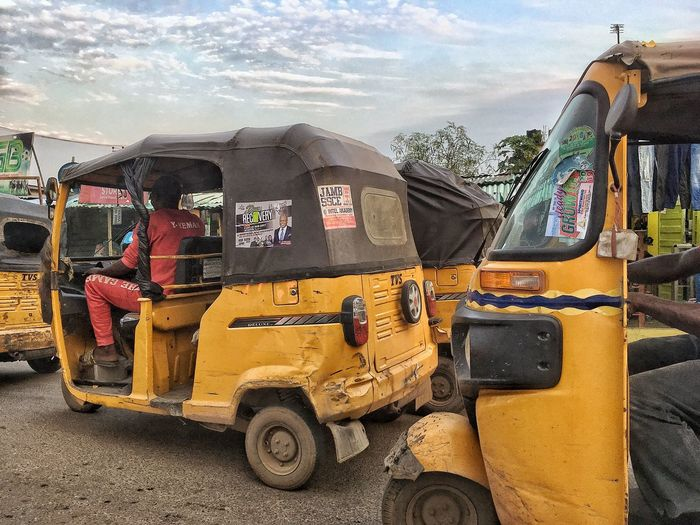 Lagos Mode Of Transportation Land Vehicle Transportation Day Nature Sky Motor Vehicle No People Car Cloud - Sky Outdoors Sunlight Road Land Built Structure City Truck Stationary