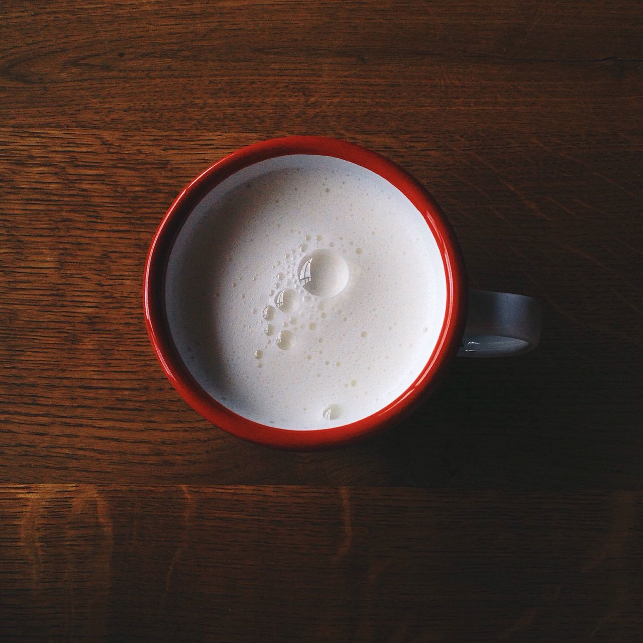 Directly Above Shot Of Milk In Mug On Wooden Table