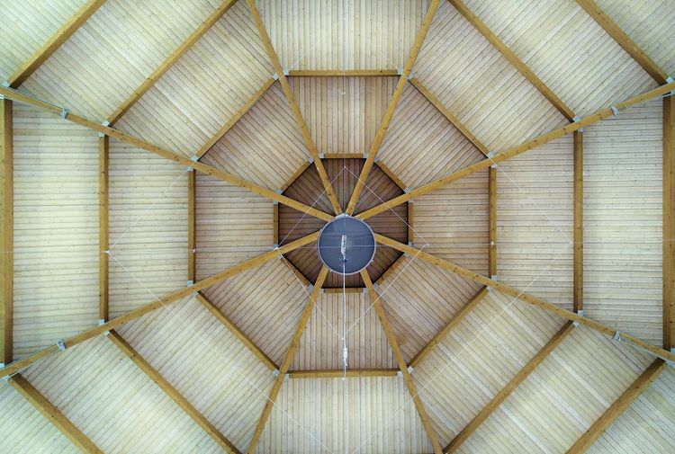 Geometric pattern found on the ceiling of a shopping mall, where the wooden beams and slats cross each other forming a regular shape Architecture Architecture Backgrounds Brown Built Structure Ceiling Circle Concentric Cupola Day Design Directly Below Electric Lamp Full Frame Geometric Shape Hexagon Indoors  Low Angle View Luxury No People Ornate Pattern Roof Shape Wood - Material The Architect - 2018 EyeEm Awards The Still Life Photographer - 2018 EyeEm Awards The Traveler - 2018 EyeEm Awards