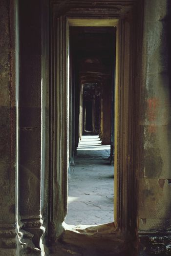 a corridor in cambodia EyeEmbestshots Architecture Architecturelovers DoorsAndWindowsProject